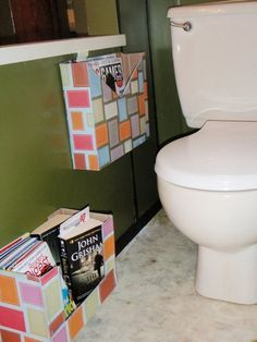 Magazine Holders made out of cereal boxes... Cool idea.. Don't like mags/ books on bathrooms... But somehow (?) they are always in there!