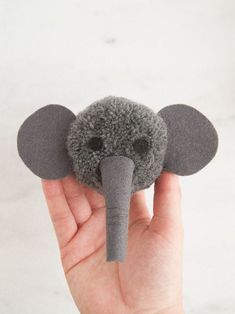 Make a miniature pom pom version of everyone's favorite gentle giant: the elephant! Animal Crafts For Kids, Fun Crafts For Kids, Craft Stick Crafts, Diy For Kids, Crafts To Make, Diy Crafts, Acrylic Cake Stands, Pom Pom Tutorial, Pom Pom Animals