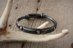 Viking style bangle bracelet. Forged steel with brass