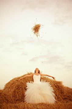 Great shot for a Country wedding.  looks like fun. hope there arent any surprisesin that hay  bale