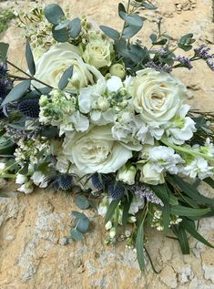 White bouquet with dusty greens and blues