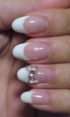 I'm not particularly a fan of artificial nails, but this is cute! French Tip with Gem Bow