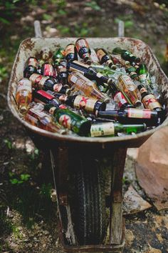 Antique wheelbarrow for drinks / http://www.deerpearlflowers.com/wagon-wheelbarrow-country-wedding-ideas/
