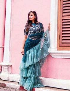 Ruffle Saree Style is the Hottest Trend of this Season 2018 - - Ruffle saree is a traditional saree style with a twist are the major attraction for the Bollywood actresses. Drape Sarees, Saree Draping Styles, Saree Styles, Blouse Styles, Simple Sarees, Trendy Sarees, Stylish Sarees, Fancy Sarees, Indian Designer Outfits