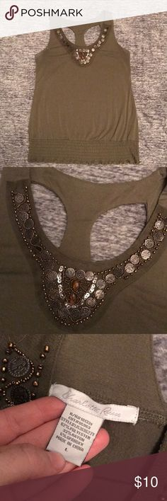 Fancy top Wear it casual or dress it up for a night out. Form fitting but stretchy. Very comfortable. Has been worn but in good condition. All the jewels on top are in good condition. Charlotte Russe Tops Tank Tops