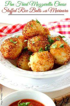 Pan Fried Mozzarella Cheese Stuffed Rice Balls are crunchy on the outside, creamy on the inside, and stuffed with lots of melted cheese! What's not to love? - Kudos Kitchen by Renee - www.kudoskitchenbyrenee.com