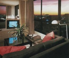 "black couch, red pillows, palm, tv static, white standing lamps, sunset   palmandlaser  From ""The International Collection of Interior Design"" (1985)"