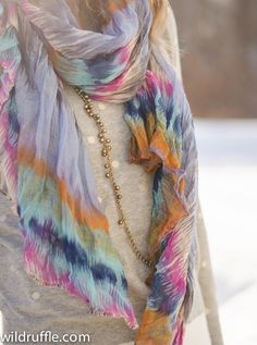 layering scarves and long necklaces