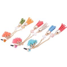 3.5mm earphone dust proof plug charm  The cute headphone jack dust plug charm features three charm : a pink fabrics flower inserted on receptacle paved with dazzling rhinestones; Pink and beige rabbit Fur Trim Tassels with Swarovski hang from gold plated links.The earphone plug charm not only prevent your earphone jack from getting dust, it will be an unique headphone jack accessory for phones .    Three colors is available : Blue, Orange and Pink