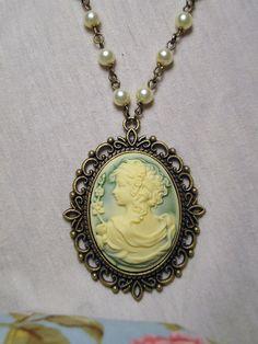 cameo ... aqua or jade color ... pretty with the ivory