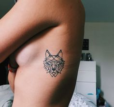 Dainty geometric wolf tattoo.