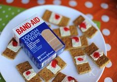 Bloody Band-Aids No actual blood here, but the simple use of graham crackers, cream cheese, and strawberry jelly is enough to put you in the Halloween spirit!