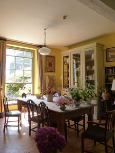 Dining room with beautiful china cabinet and built-in bookcase.