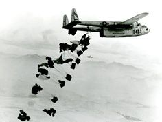 Fairchild C-119 Flying Boxcar - on a supply mission to drop rations and gasoline to UN troops on a battlefield near Chungju, Korea. Look close, and you can see a second Boxcar in the far background. The C-119 entered service late in 1949.