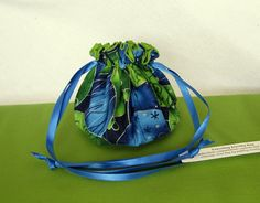"""Jewelry Bags make excellent Christmas gifts.  We can get them to you before Christmas.  Order by 10 am EST and they will be shipped that day.  Each of our bags have individual compartments inside to separate and protect your jewelry.  We offer 5 sizes of bags in over 300 colors.  Bag shown:  """"Christmas Glitz"""" $7.00 @IslandJewleryBags.etsy.com #Jewelry Bag"""