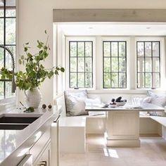 White kitchen nook with steel frame windows