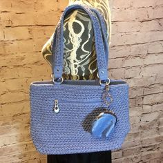 NWOT SONOMA CROCHET SHOULDER BAG IN PERIWINKLE This is such a pretty color and perfect for summer. It's never been used but last pic shows a small stain on the strap. Also included is a matching coin purse. Sonoma Bags Shoulder Bags