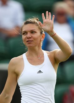 Simona Halep Photos - Simona Halep of Romania celebrates victory during the Ladies Singles first round match against Anna Karolina Schmiedlova of Slovakia on day one of the Wimbledon Lawn Tennis Championships at the All England Lawn Tennis and Croquet Club on June 27th, 2016 in London, England. - Day One: The Championships - Wimbledon 2016