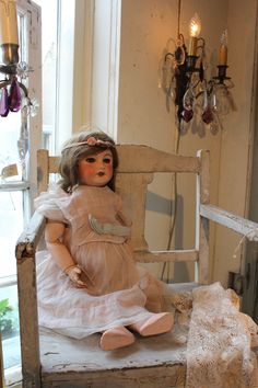 Doll with pink dress.