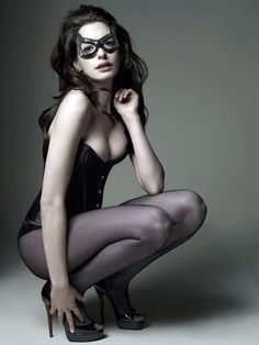 Catwoman...a stunning and sleek seductress. Feminity, felinity,and a dash of villiany. Meow. (Batman, Dark Knight Rises, Anne Hathaway)
