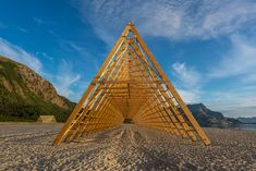 rintala eggertsson installs fish rack structures on norway beach for SALT festival