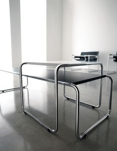 Marcel Breuer's Laccio tables; the higher was originally designed as seating.