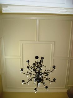 Flat Ceiling Panel With A Raised Panel Molding In Foyer