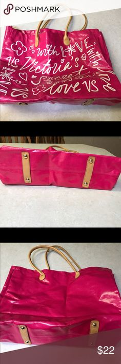 Large Victoria's Secret tote. Large Victoria's Secret Tote. Hot pink with white lettering and tan handles.  The roomy inside has a floral pattern. There is a small discoloration on a couple of the letters (not photos). Since I have never used the bag I don't know how this happened. Victoria's Secret Bags Totes