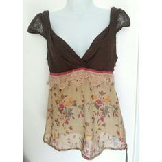 Free People floral tank top Free People boho tank top. Brown embroidered design on top, semi-sheer flowy floral bottom. Low neckline and low back. Size 6, small. Never worn. In very good condition.   #freepeople #tanktop #bohochic #bohofashion #nwot #neverworn Free People Tops Tank Tops