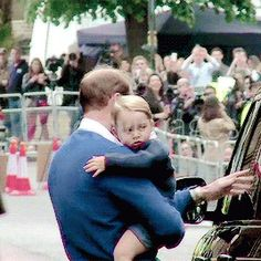 May 2, 2015 - Prince William getting Prince George out of the car to see his new sister at the hospital for the first time.