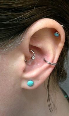 My new smaller daith hoop, conch hoop, helix opal, and 8g turquoise