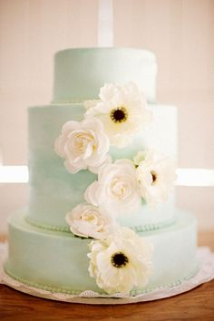 mint colored cake with flowers and beading