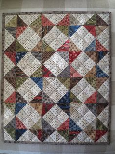 Kindred Quilts: Tabitha's Trinkets. Charm squares. Quarter square blocks in alternating darks and lights. Designer used shirting fabric scraps and a charm pack.