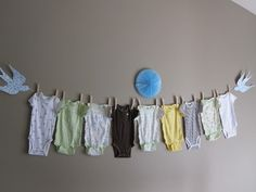 Idea for first birthday party - hang onesies the baby has worn from birth to birthday.