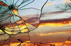 Sunset and trees reflected in broken mirrors