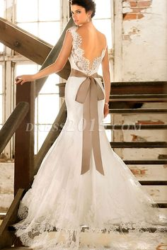 Beautiful laced open back dress, but the brown bow would be a light pink to match the theme.