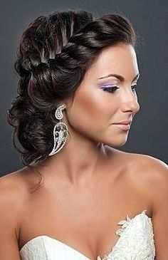 Magical braided updo. All the hair elegantly off of her face.