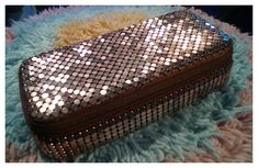 Modern unbranded mesh - an unusual zip around jewellery box in bronze metal mesh and chocolate brown silky material. This was bought for the unbelievable low price of $2.00.