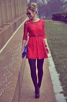 Choose a red lace skater dress for a standout ensemble. Add black suede pumps to your look for an instant style upgrade.  Shop this look for $81:  http://lookastic.com/women/looks/sunglasses-earrings-skater-dress-belt-watch-clutch-tights-pumps/7696  — Black Sunglasses  — Gold Earrings  — Red Lace Skater Dress  — Black Leather Belt  — Gold Watch  — Blue Leather Clutch  — Black Wool Tights  — Black Suede Pumps