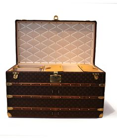 Antique Louis Vuitton Steamer Trunk in the front entry of Bliss Linens
