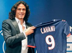 Striker Edinson Cavani of Uruguay display his new jersey during a press conference after he officially signed for the Paris Saint Germain (PSG) soccer team, at the Parc des Princes stadium in Paris, Tuesday, July 16, 2013. (Jacques Brinon/AP)