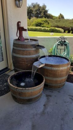 Wine barrel and whiskey barrel furniture decor, accessories, pet beds, kitchen, lighting Wine Barrel Water Feature, Whiskey Barrel Fountain, Wine Barrel Diy, Wine Barrels, Wine Barrel Planter, Table Baril, Diy Garden Fountains, Water Fountains, Diy Water Fountain