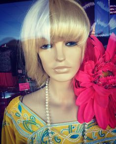 https://flic.kr/p/FXnhCS | Blonde Mannequin | Blonde mannequin with a flower, as seen in a clothing store window.