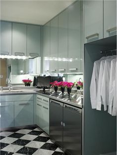 Elegant Contemporary Laundry Room by Jamie Herzlinger. #laundryroom homechanneltv.com