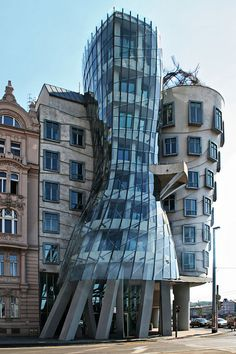 Prague. The Dancing House or Dancing Building or Ginger & Fred (Czech: Tančící dům) by Croatian-Czech architect Vlado Milunić in co-operation with Canadian-American architect Frank Gehry, designed in 1992 and completed in 1996.