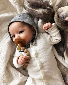 Bonnets + Pacifiers + Pacifier Clips + = all in stock in the shop! #briarhandmade #natursutten #nomilu image via @pamelabearden ps. do all babies do that cute thing with their fingers, mine did and I had forgotten until I saw this photo