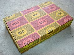 Box covered with Monopoly money