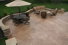 Flagstone stamped patio with gas firepit with Fyre glass in blue color
