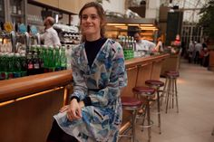 12.45 Miriam Stein waiting for lunch in Palmenhaus Vienna - wearing the A Day in a Life Mountain Printed Silk Chiffon Shirt Dress and the Navy Ribbed Turtleneck Dress