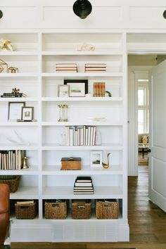 Organizing your home is key. Love this nook filled with shelves.
